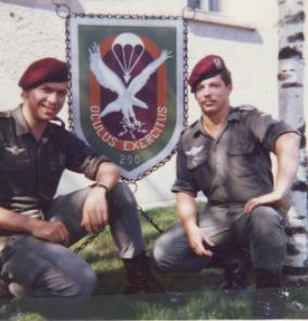 Soldiers from Fernspähkompanie 200 posing in front of unit sign on Argonnen Kaserne, Weingarten